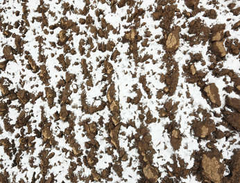 snow frozen ground farmland clay