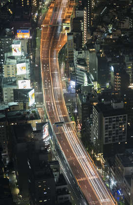 aerial city buildings background night dark highway metropolis Tokyo Japan location: Mori building