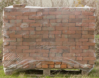 brick stack stacked cargo plastic wrapped wrap pallet prop
