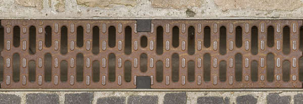 sewer grid lid cover metal rusted drain