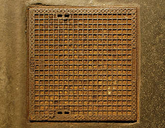 metal sewer lid big square rust