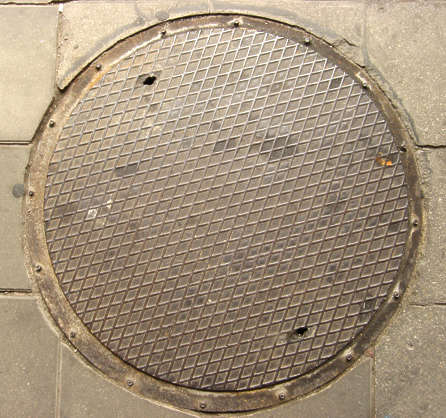 sewer manhole round big metal