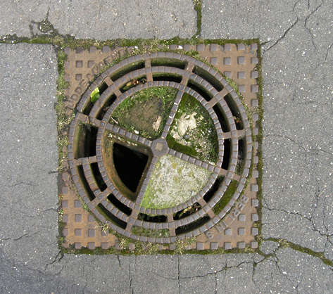 sewer grate lid metal small round
