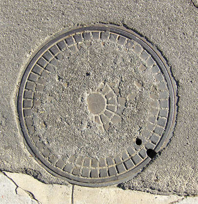 sewer lid big manhole round metal asphalt isolated
