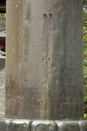 metal bronze copper worn old corroded corrosion pillar temple japan