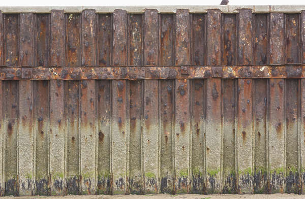 metal dock harbour seaside bulkhead waterside riverside wall mossy UK