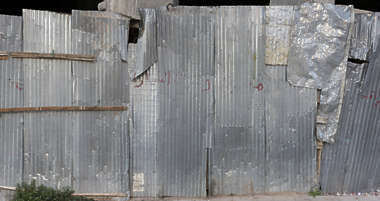 morocco metal plate bare worn old fence damaged crumpled