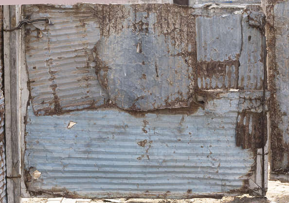 metal plate plates crumpled damaged worn old rusted derelict