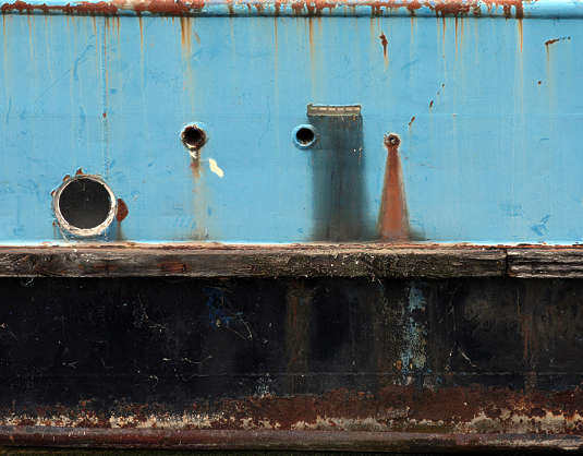 metal ship hull window porthole dirty leaking