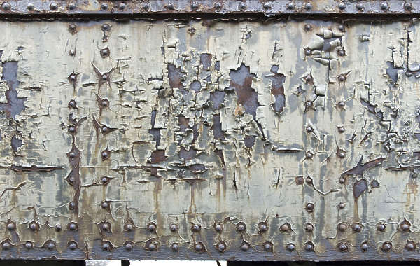 paint crackles cracks rivets seam train cracked old weathered