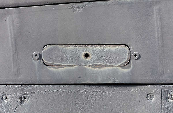 submarine metal seam painted bolts hatch