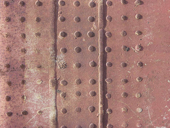 metal seam rivets nails old rust closeup