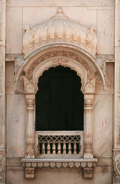 india window ornate arch marble balcony