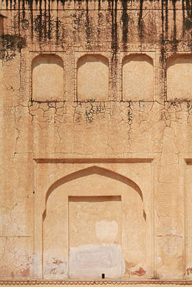 india arch ornament wall plaster leaking
