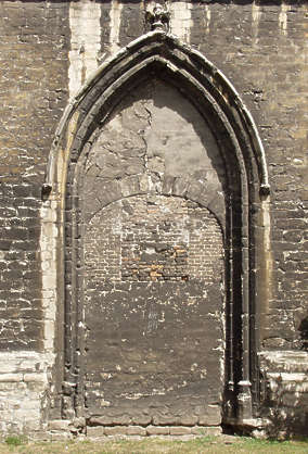 door old church closed shut stone dirty bricked arch