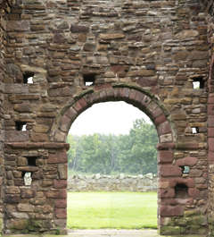 brick medieval ruins messy church entrance arch archway UK