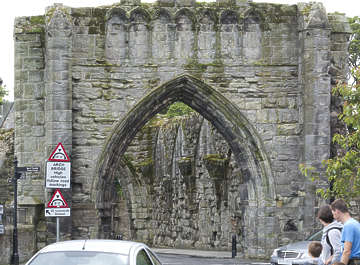 brick medieval arch archway castle cathedral church ornate old mossy UK