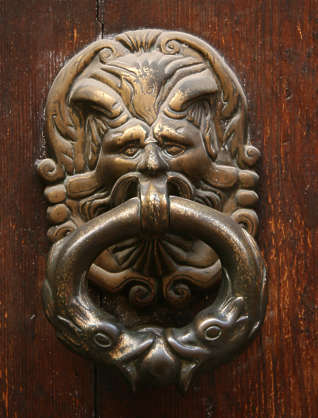 door knocker head demon ornament