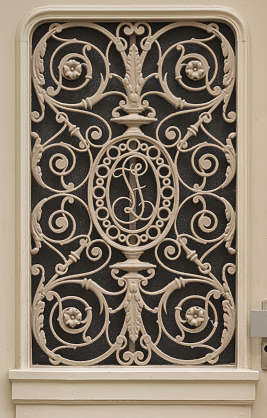 window grate metal ornate ornament door curls wrought iron