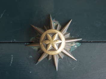 ornament doorknob star spike flower gold