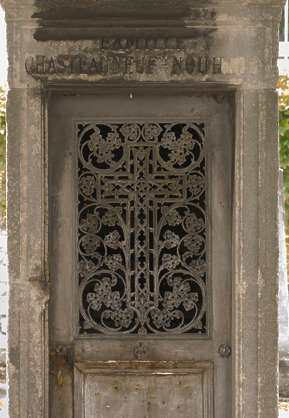 door old rusted medieval cementary metal mausoleum tomb ornate
