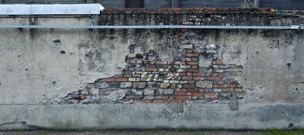 plaster old damaged brick wall