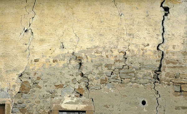 plaster wall brick damaged old