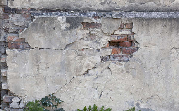 plaster damaged brick bricks