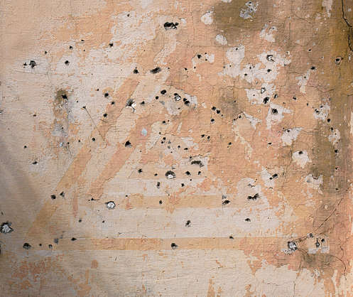 plaster damage holes bullet hole