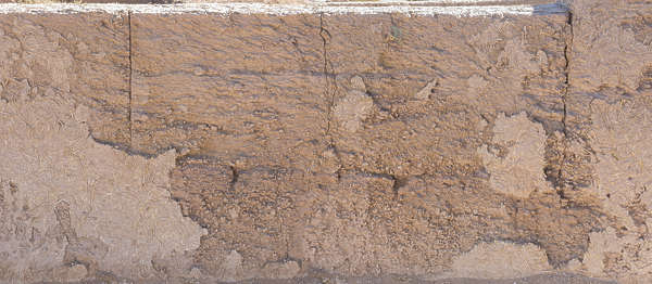 morocco loam wall mud plaster old medieval worn blocks eroded clay