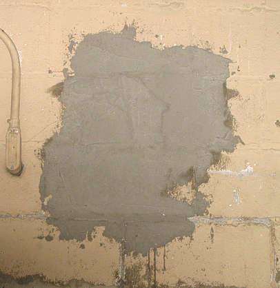 concrete damaged plaster stain patched