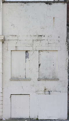 UK building facade plaster old dirty