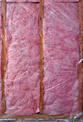 wall insulation under construction pink