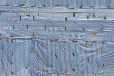 plastic tarp building facade side china