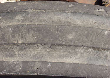 plastic rubber dirty old thread wheel profile worn cracked tyre tire