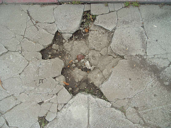 concrete cracked crack damaged hole