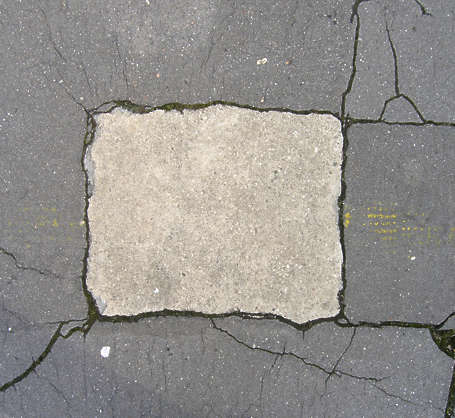 asphalt street repaired pothole cracks cracked