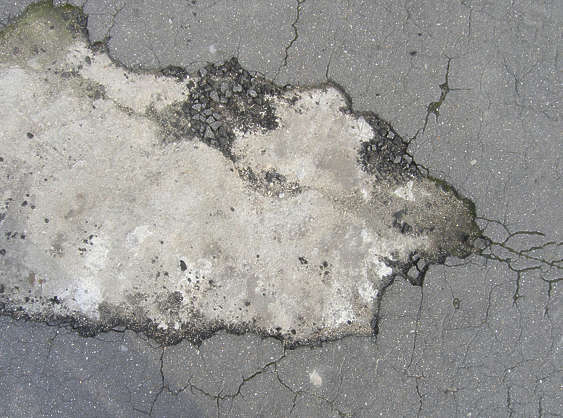 asphalt street cracks cracked damaged pothole