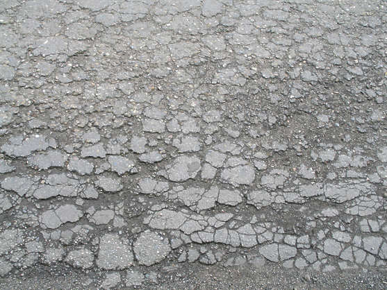 asphalt tarmac cracked cracks damaged