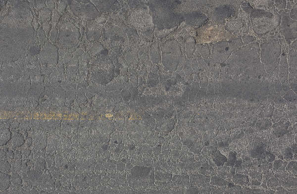 aerial asphalt street road worn damaged old pothole holes