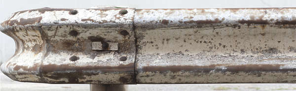 guard rail pole guardrail metal old rusted weathered painted