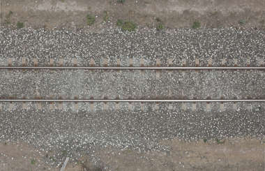 aerial ground terrain rails railway rail gravel train track tracks