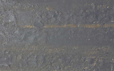 aerial street road highway asphalt tarmac old cracked cracks damaged worn