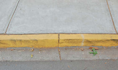 curb yellow concrete