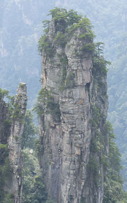 china rock rocks cliff cliffs Zhangjiajie landscape background formation jungle overgrown grassy