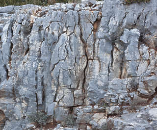 rock cliff stone cracked cracks jagged