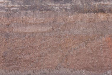 rock cliff rough layered sediment