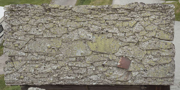roof rooftiles slate old medieval plates stone Switzerland mossy lichen moss barn