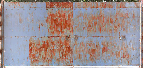 door metal gate big rust rusted paint painted