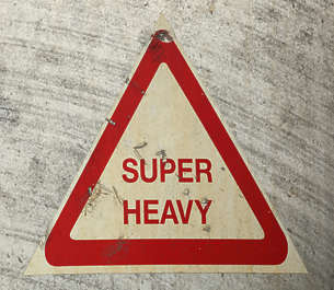 sign warning super heavy